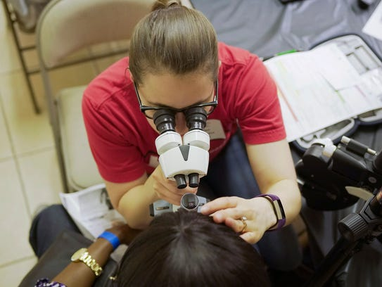 A patient is screened for cataracts March 12 in Houston