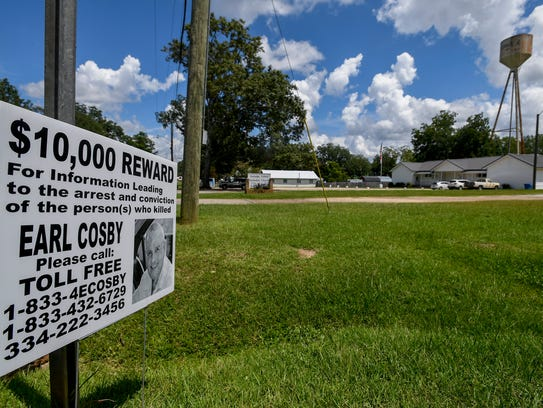 Signs offering a $10,000 reward for information leading