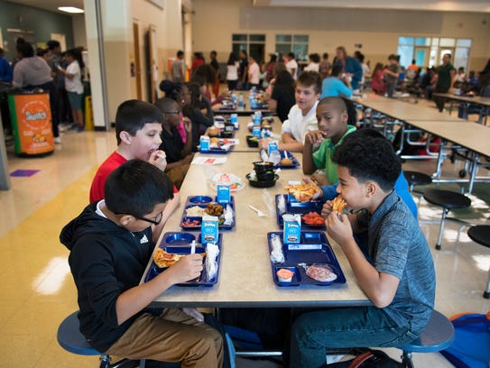 Students at Tanglewood Middle School eat lunch on Wednesday,