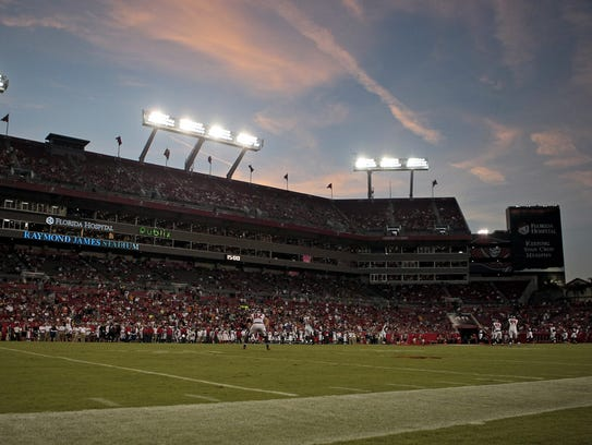 The sun sets over Raymond James Stadium in Tampa, Fla..