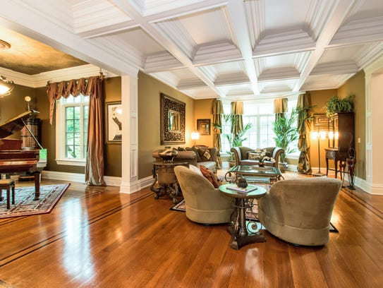 The living room has a coffered ceiling and is open