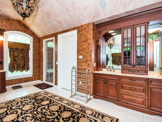 This home has six full baths and two half baths, all