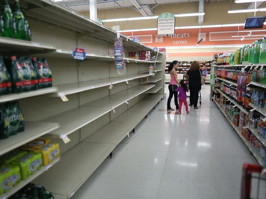 Bare shelves are seen at a  grocery store in Homestead,