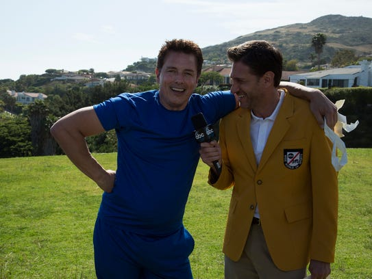 """(L to R) John Barrowman and Mike Greenberg on """"Battle"""