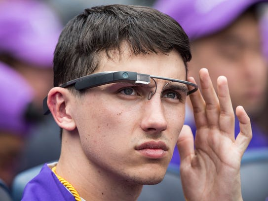 A student wears Google Glass at the 2014 New York University