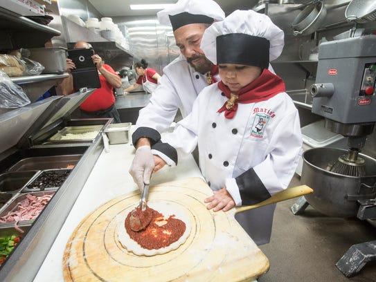 Mario Del Guidize, owner of Mario's Italian helps Cohen