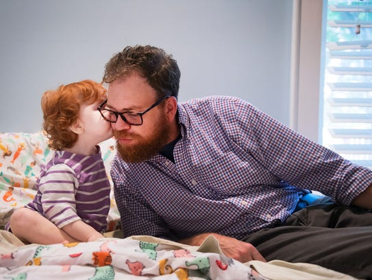 Drew Duffey receives a kiss from his daughter, Katie,