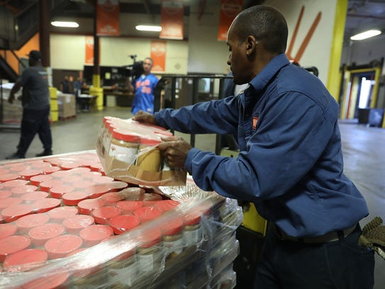 Workers for the Food Bank For New York City pack a