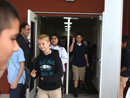 Principal George Abounader often holds the doors for