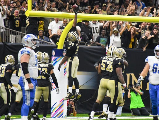 Defensive end Cameron Jordan dunks the ball over the