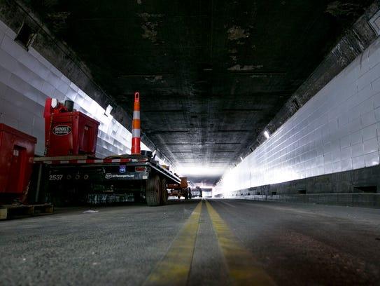 Construction equipment sits inside the Detroit Windsor