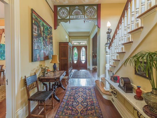 The grand entrance leads to the beautiful staircase