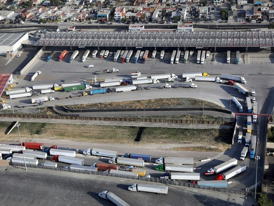 Freight trucks, as seen from a helicopter, snake from