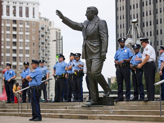 In this Sept. 14 file photo, police officers guard