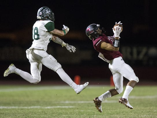 Red Mountain's Shaq Daniels makes an interception against