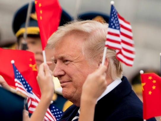 File photo shows children waving U.S. and Chinese flags