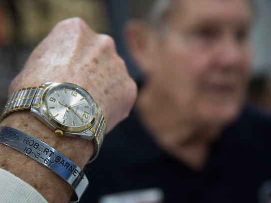 Don Barnett, of Sun City Palm Desert, wears a bracelet