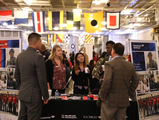 Job seekers talk with recruiters at Bank of America