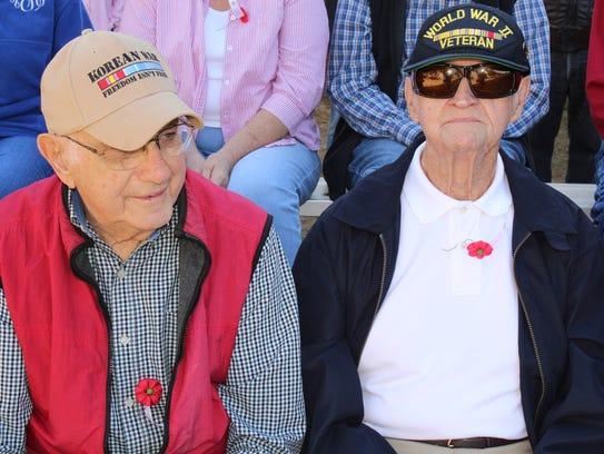 Korean War veteran Charles Pollack, left, and World