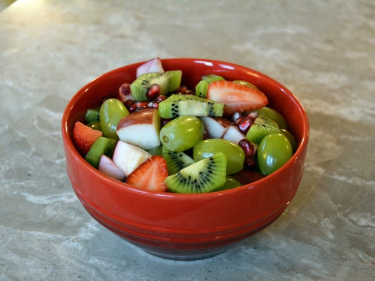 Greens and reds make this fruit salad perfect for a