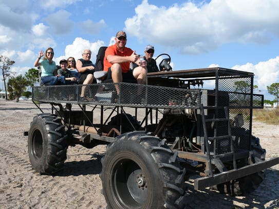 Visitors get the tour on swamp buggies. Environmentalists