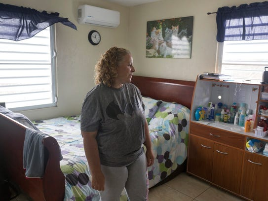 Zaida Lopez takes a moment while in her 18-year-old son's bedroom.