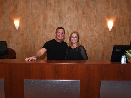 Co-owners Rick and Lisa Popoff behind the front desk.