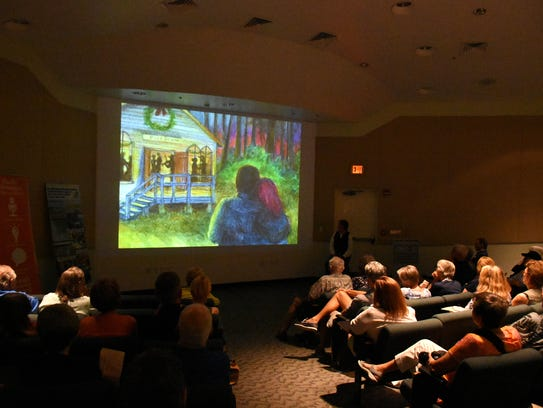The audience looks at a scene from Florida's pioneering