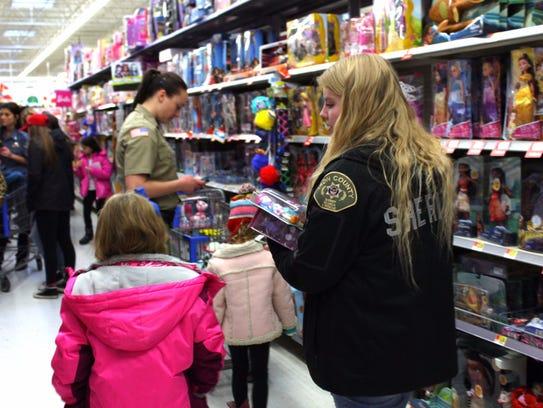 Cedar City's annual Shop With A Cop event, Saturday,
