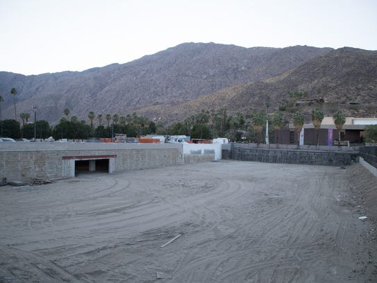 Ongoing construction can be seen from the ribbon-cutting