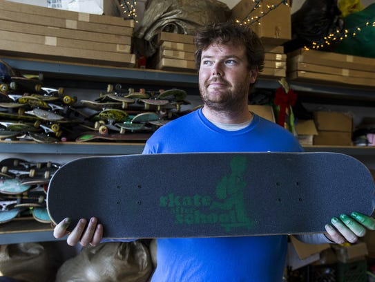 Tim Ward holds a Skateboard Angel board on Thursday,