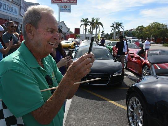 Naples Mayor Bill Barnett shoots photos of the hot