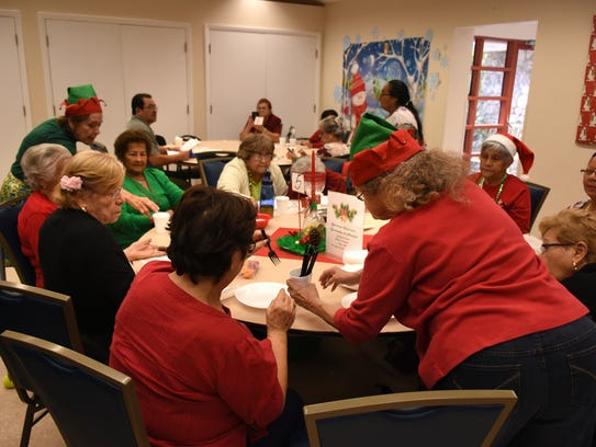 Volunteers serve lunch for the guests at the Golden