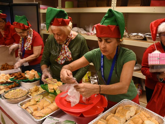 Volunteers prepare lunch for the guests.