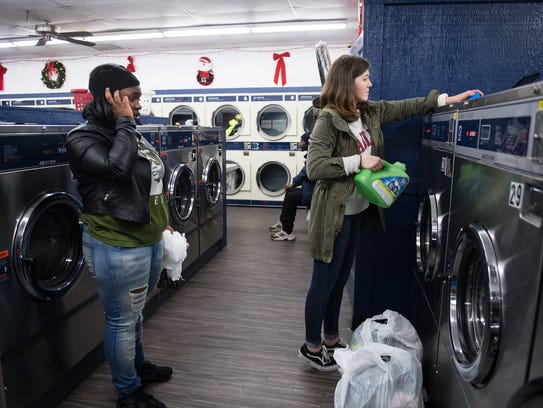 Adahlia Nix, founder of For Frankie, puts laundry detergent