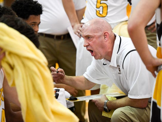 Central Head Coach Scott Hudson talks to his team during a time-out late in the fourth quarter against New Albany. The Bears finished the season with a 5-17 record.