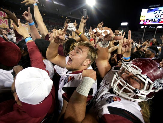 New Mexico State Aggies players and fans celebrate