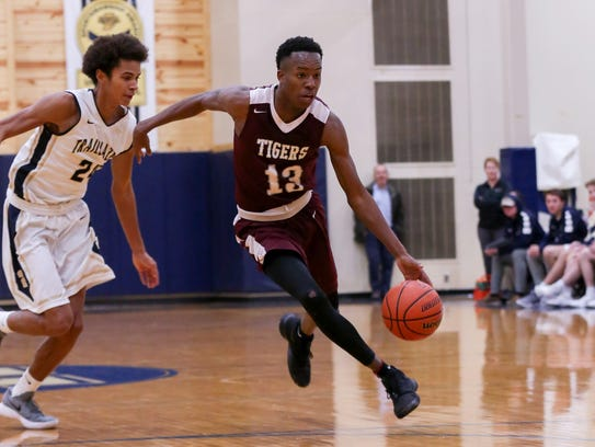 University beat Tindley 48-46 in a matchup of Class