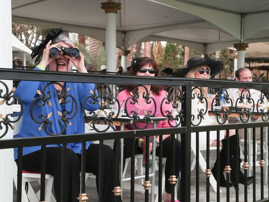Kelly Laurich peers through binoculars to get a better