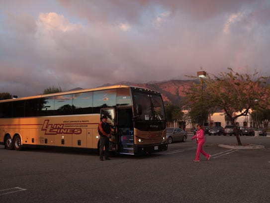 A bus of marchers leaves Palm Springs for the Women's