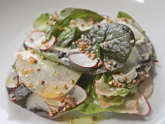 Red romaine and apple salad served at Jack Fry's in