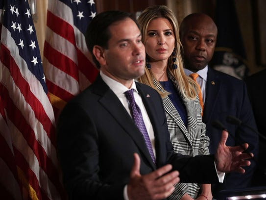 Sen. Marco Rubio, R-Fla, speaks as Ivanka Trump and Sen. Tim Scott, R-S.C., listen during a news conference about the GOP tax reform bill.