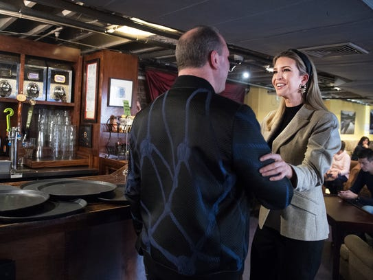 Ken Orbeck of Greenville, S.C., introduces himself to Ivanka Trump as she stops in to Coffee Underground on Friday, Jan. 26, 2018.