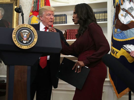 President Trump listens to Omarosa Manigault Newman