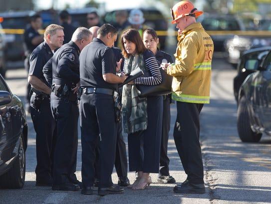 Los Angeles Fire department's Erik Scott, far right,