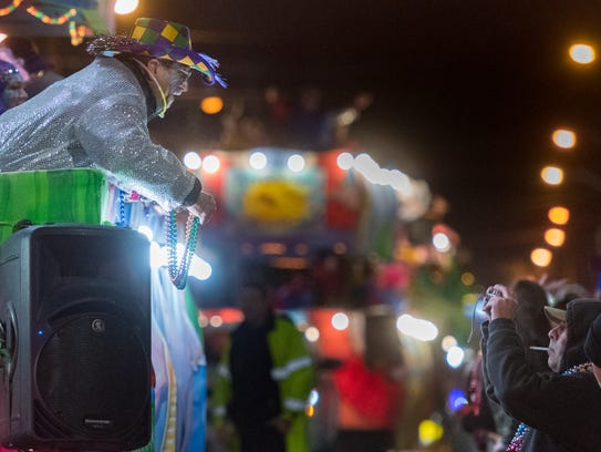 The Rio Mardi Gras parade rolls through downtown Lafayette,