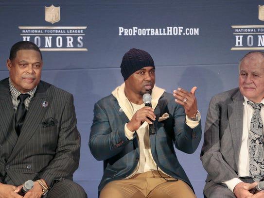 Former NFL players, Robert Brazile, Brian Dawkins,