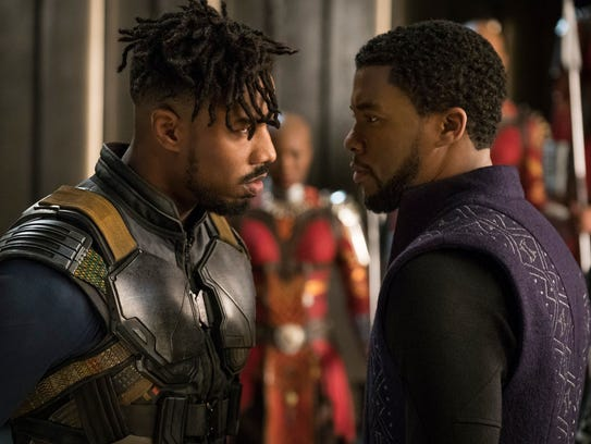 Michael B. Jordan, left, and Chadwick Boseman go head