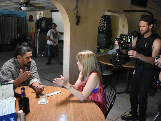Actors Chiko Mendez and Ash Hamilton film a scene.