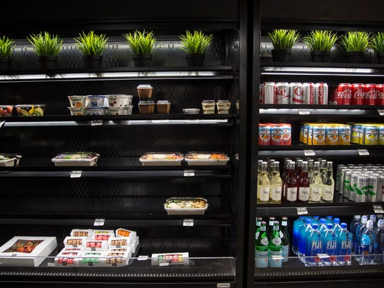 Salads, deserts and old to-go items for sale in a cold